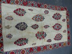 A SUSANI, POSSIBLY UZBEK, THE WHITE FIELD EMBROIDERED WITH FLORAL OVALS WITHIN A BAND OF RED
