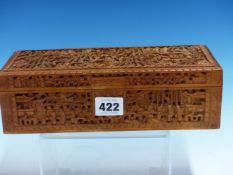 A CHINESE WOODEN BOX, THE SIDES AND HINGED RECTANGULAR LID CARVED IN RELIEF WITH FIGURES IN LEAFY