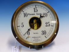 SIR W H BAILEY & CO, A WALL MOUNTING VACUUM GUAGE WITH THE PAPER DIAL MEASURING IN INCHES, THE BRASS