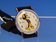 A VINTAGE MANUAL WOUND TIMEX MICKEY MOUSE WRIST WATCH. INCLUDED ARE PHOTOGRAPHS FROM A RECENT