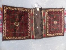 A BELOUCH TRIBAL SADDLE BAG 143 x 66cms.
