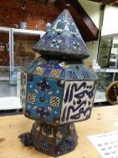 AN ISLAMIC TURQUOISE ENAMELLED AND JEWELLED OCTAGONAL LANTERN PIERCED WITH PANELS OF BLUE AND WHITE