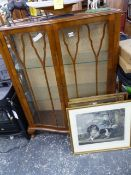A DISPLAY CABINET.