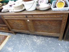 AN 18th.C.OAK COFFER WITH CARVED PANEL FRONT.