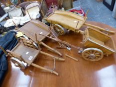 FOUR HAND MADE FARM CARTS AND A PLOUGH.