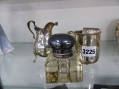 A HALLMARKED SILVER CARD CASE, A CHRISTENING TANKARD, A SILVER CREAM JUG AND AN INKWELL.