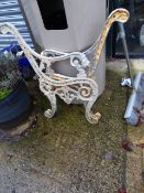 A PAIR OF PAINTED CAST ALUMINIUM BENCH ENDS.