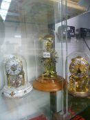 A VINTAGE SKELETON CLOCK AND TWO OTHERS.