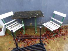 A GARDEN TABLE WITH PAINTED CAST IRON BASE TOGETHER WITH A SIMILAR PAIR OF CHAIRS.