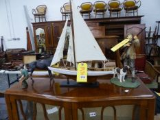 A MODEL BOAT AND TWO FIGURINES, FARRIER AND A SPORTSMAN.