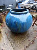 A VERY LARGE BLUE GLAZED GARDEN PLANTER.