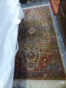 FOUR PERSIAN PATTERN RUGS AND CARPETS.