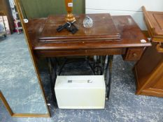 A TREADLE SEWING MACHINE AND ONE OTHER.