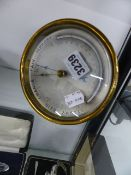 A BRASS CASED ANEROID BAROMETER AND MERCURY THERMOMETER