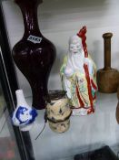 AN ORIENTAL SANG DE BOUEF VASE, A HOOKAH BOWL, A BLUE AND WHITE SMALL VASE AND A FIGURINE.
