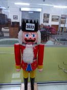 A VINTAGE WOODEN HANDPAINTED NUTCRACKER.