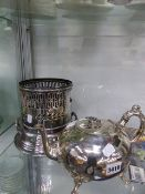 A VICTORIAN PLATED TEAPOT AND A BURNER STAND.
