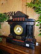 A VICTORIAN SLATE MANTLE CLOCK.