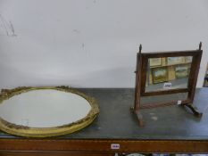 A GILT FRAMED MIRROR AND A SMALL SWING MIRROR.