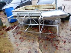 AN ALUMINIUM POTTING TABLE.