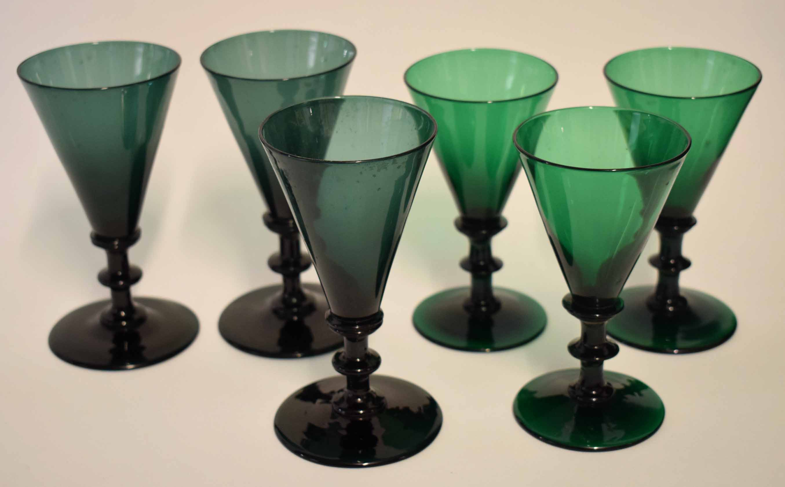 Lot 84 - Group of six green glass wine glasses of tapered shape, 14cm high