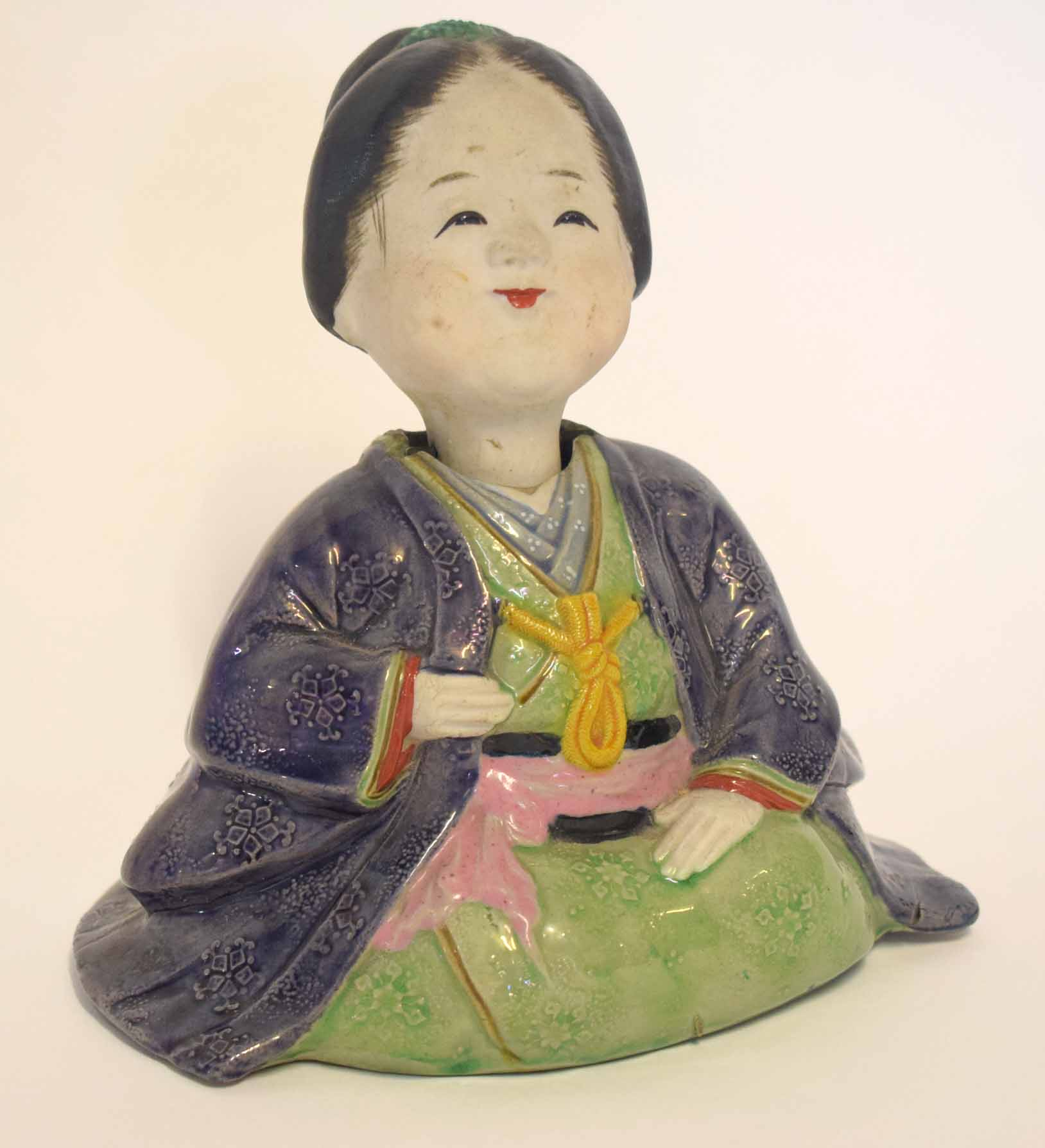 Lot 3 - Oriental pottery figure of a lady in brown and green glazes, 16cm high