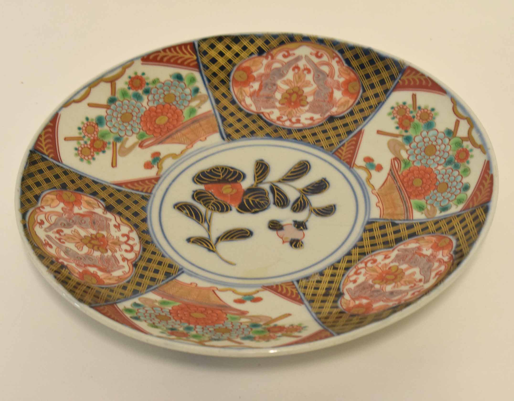 Lot 43 - Japanese porcelain dish with Imari designs and alternating panels of flower heads and dragons,
