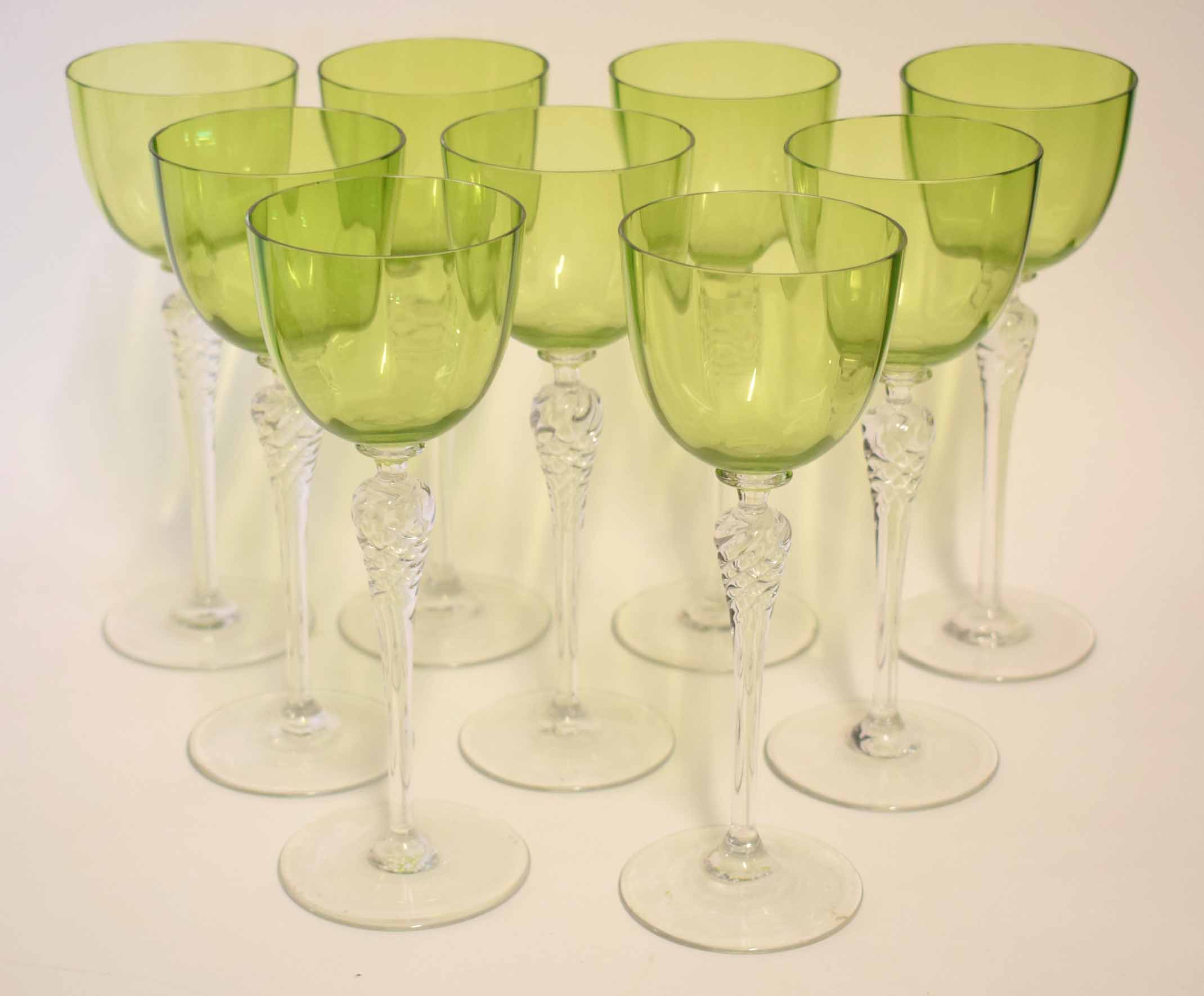 Lot 85 - Group of nine wine glasses on tall stems, the bucket shaped bowls with a light green colour, each