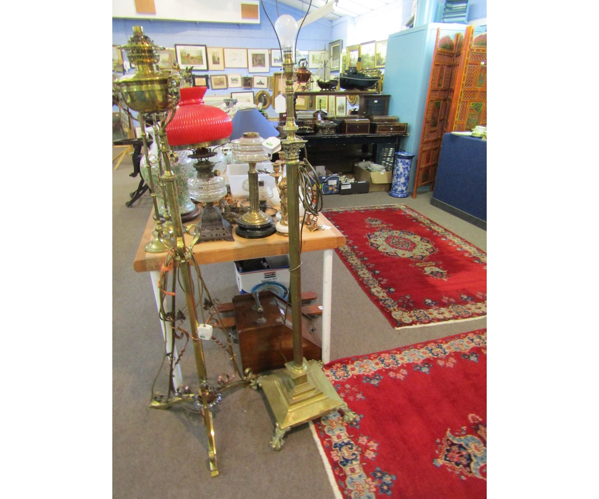 Lot 342 - Early 20th century brass telescopic standard lamp, the adjustable column contained within a
