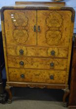 Lot 485 - 20th century walnut effect tallboy, two doors enclosing cupboard over three frieze drawers on