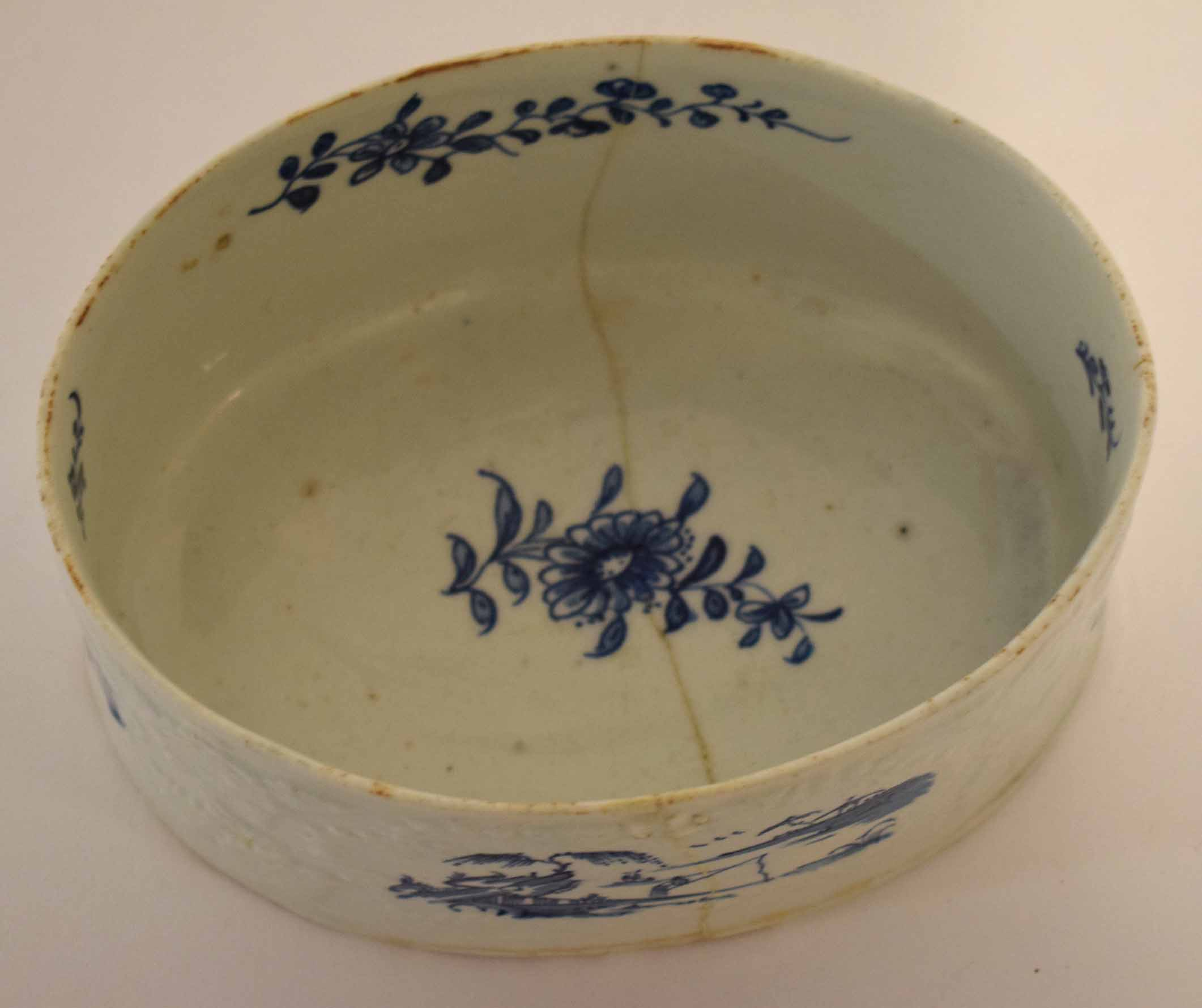 Lot 106 - Lowestoft oval shaped potting pan, circa 1765, the moulded body decorated with blue and white scenes