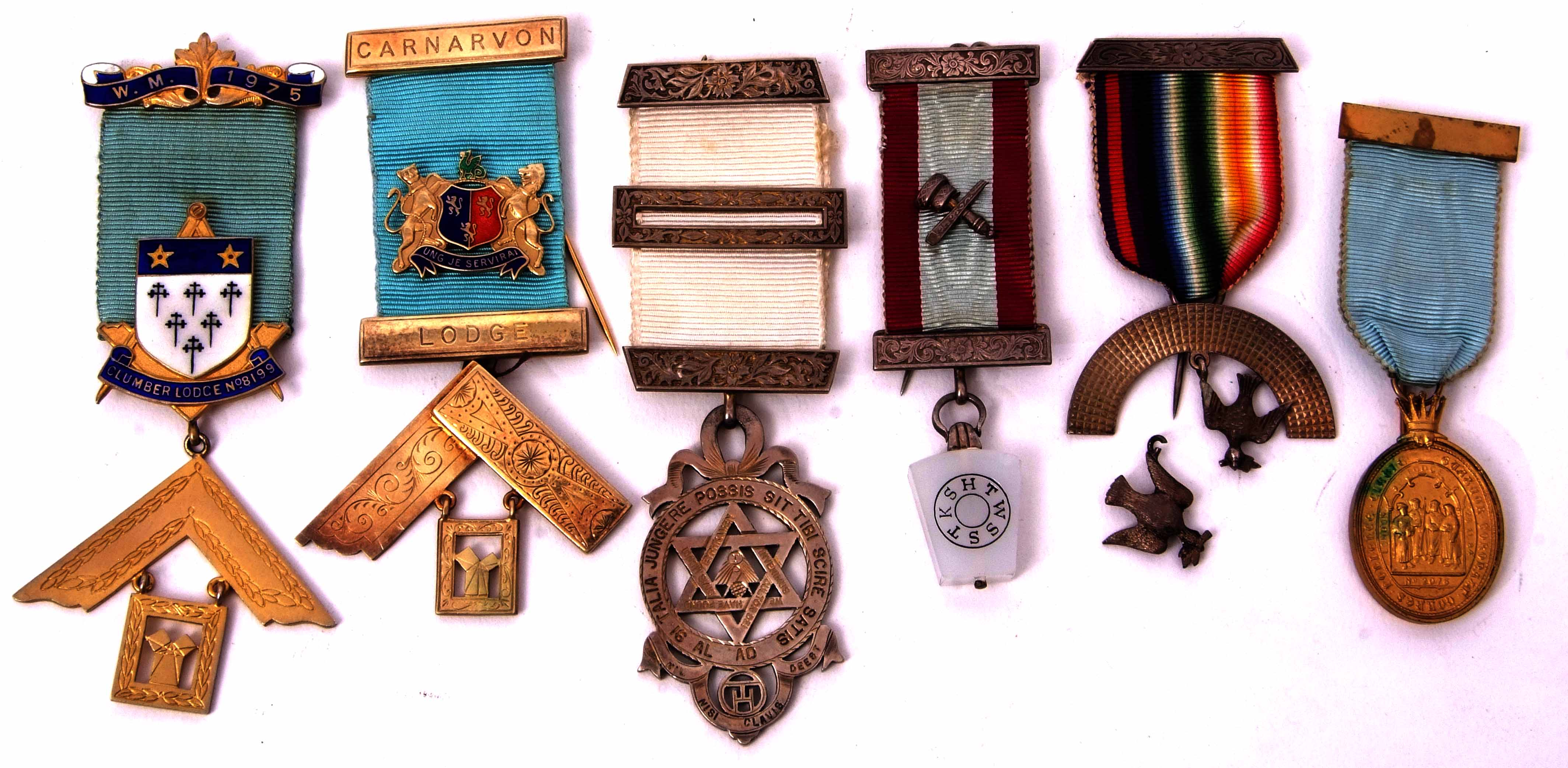 Lot 584 - Six various silver, silver gilt and base metal Masonic jewels including Caernarvon Lodge (6)