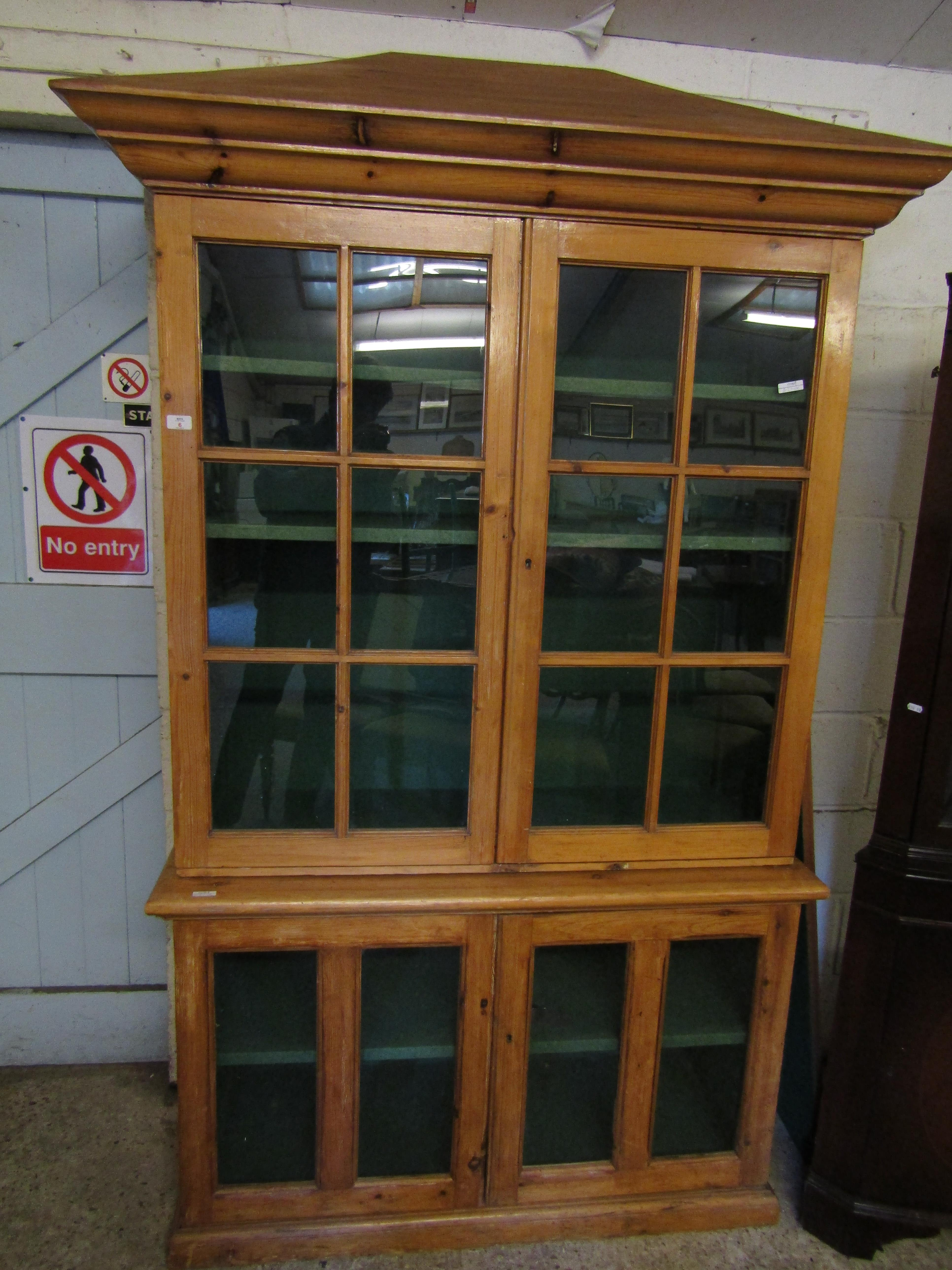Lot 6 - VICTORIAN WAX PINE BOOKCASE WITH PAGODA TOP AND FOUR GLAZED SECTIONAL DOORS
