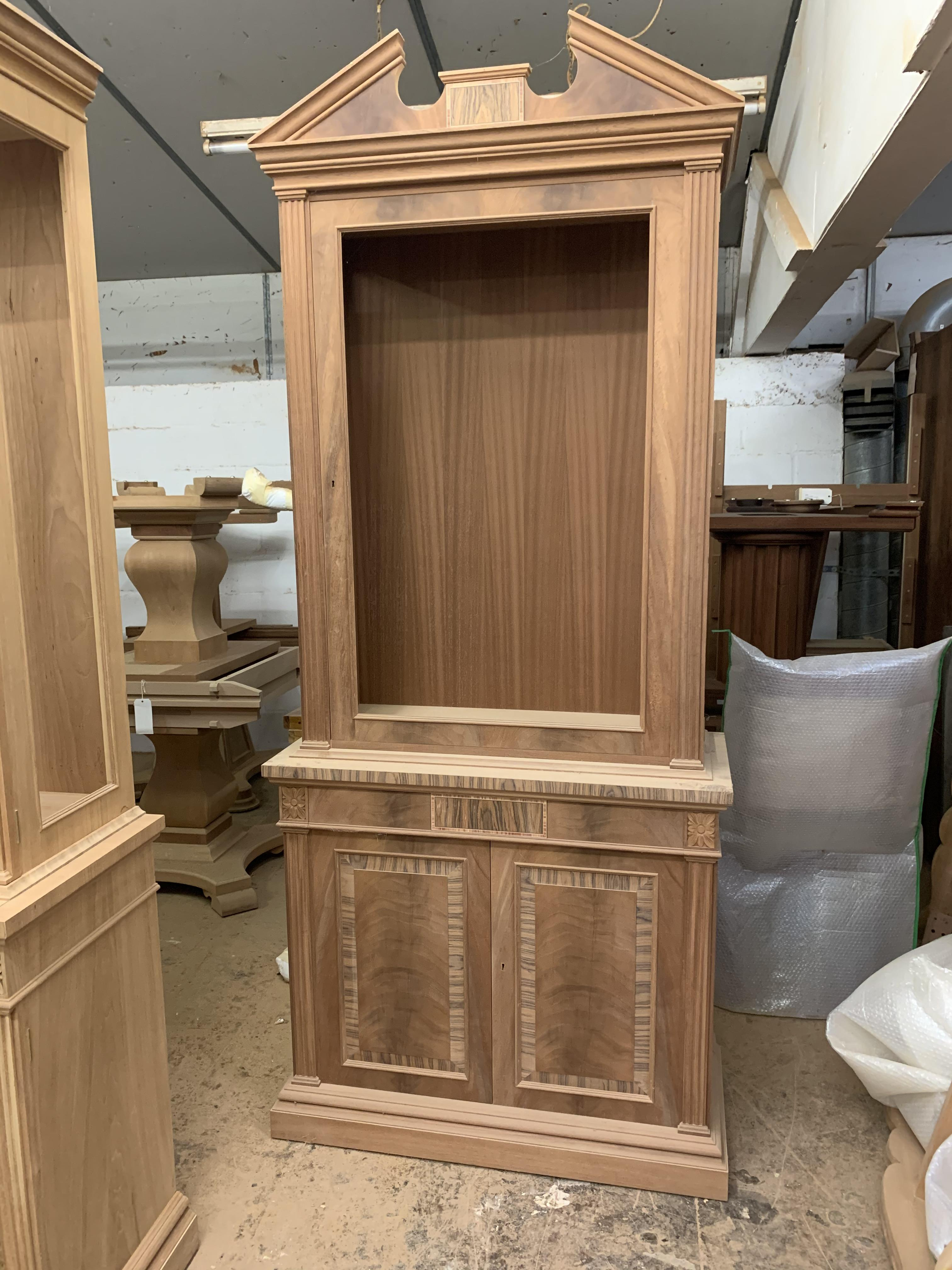 Lot 36 - Two-door tall Bookcase, in mahogany finish, from the Corinthian range, requires finishing/polishing.
