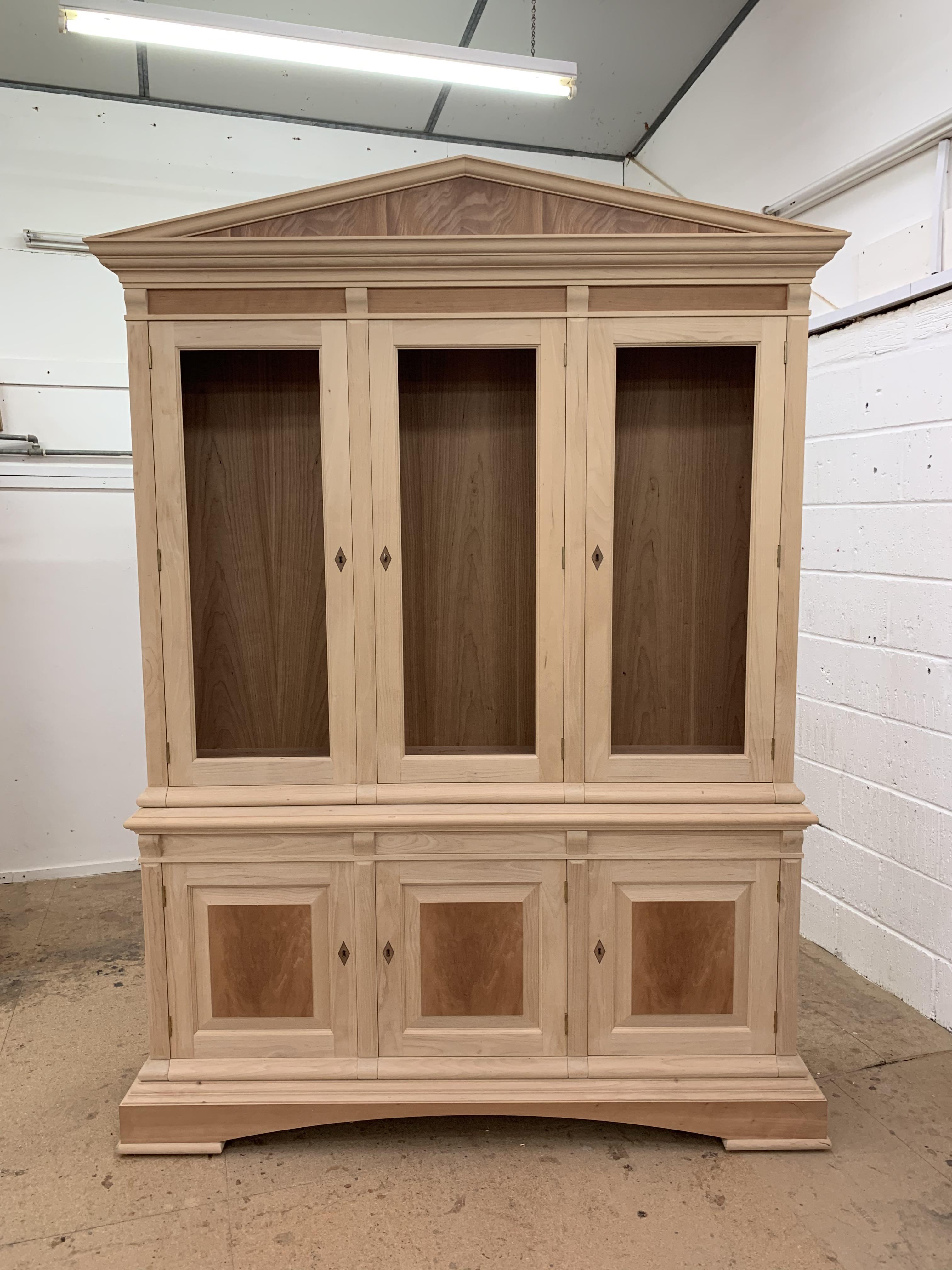 Lot 45 - Three door Bookcase, with pediment, from the Trafalgar Cherry range, requires finishing/polishing.