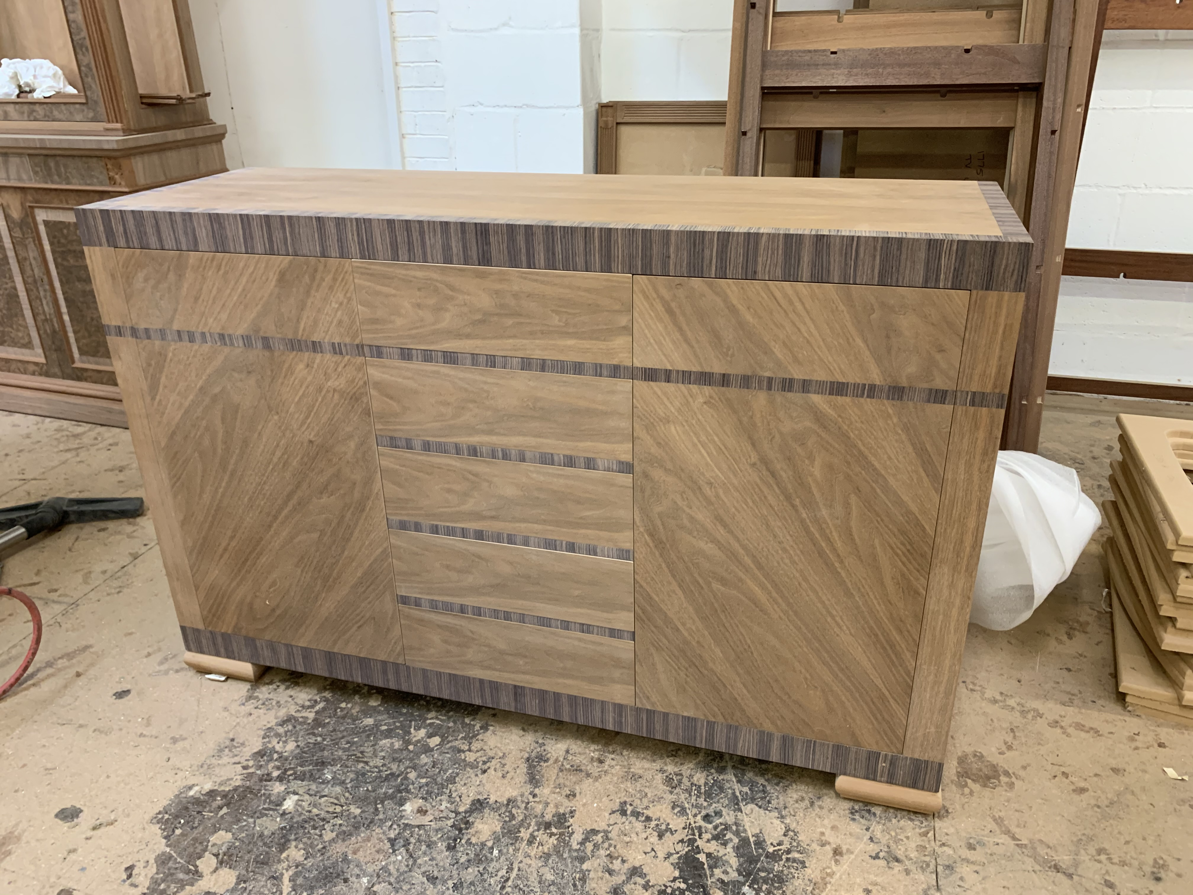 Lot 58 - Walnut finish Sideboard, a contemporary one-off prototype design with push-open cupboards, length