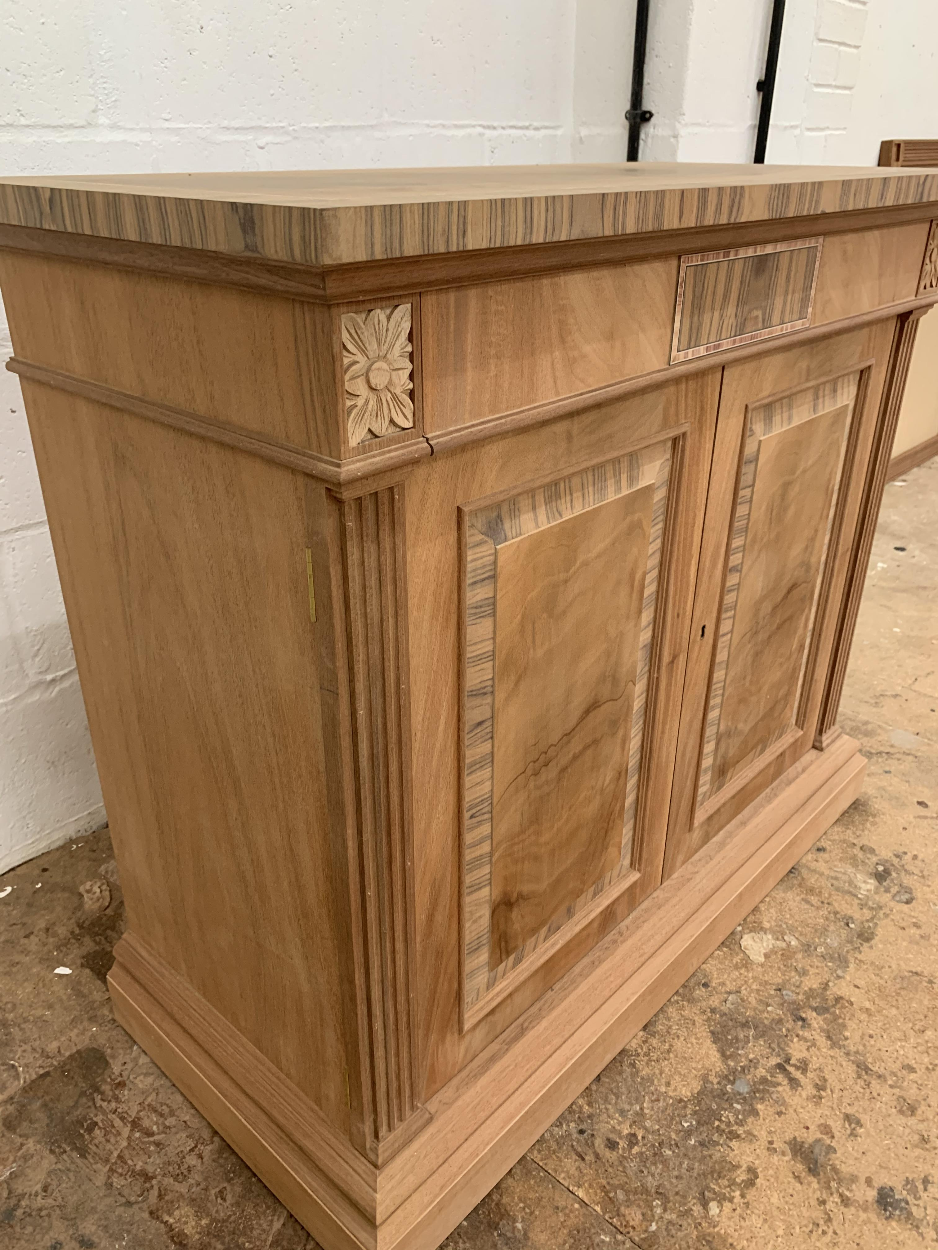 Lot 19 - Small two-door Sideboard, in Mahogany finish, from the Corinthian range, requires finishing/