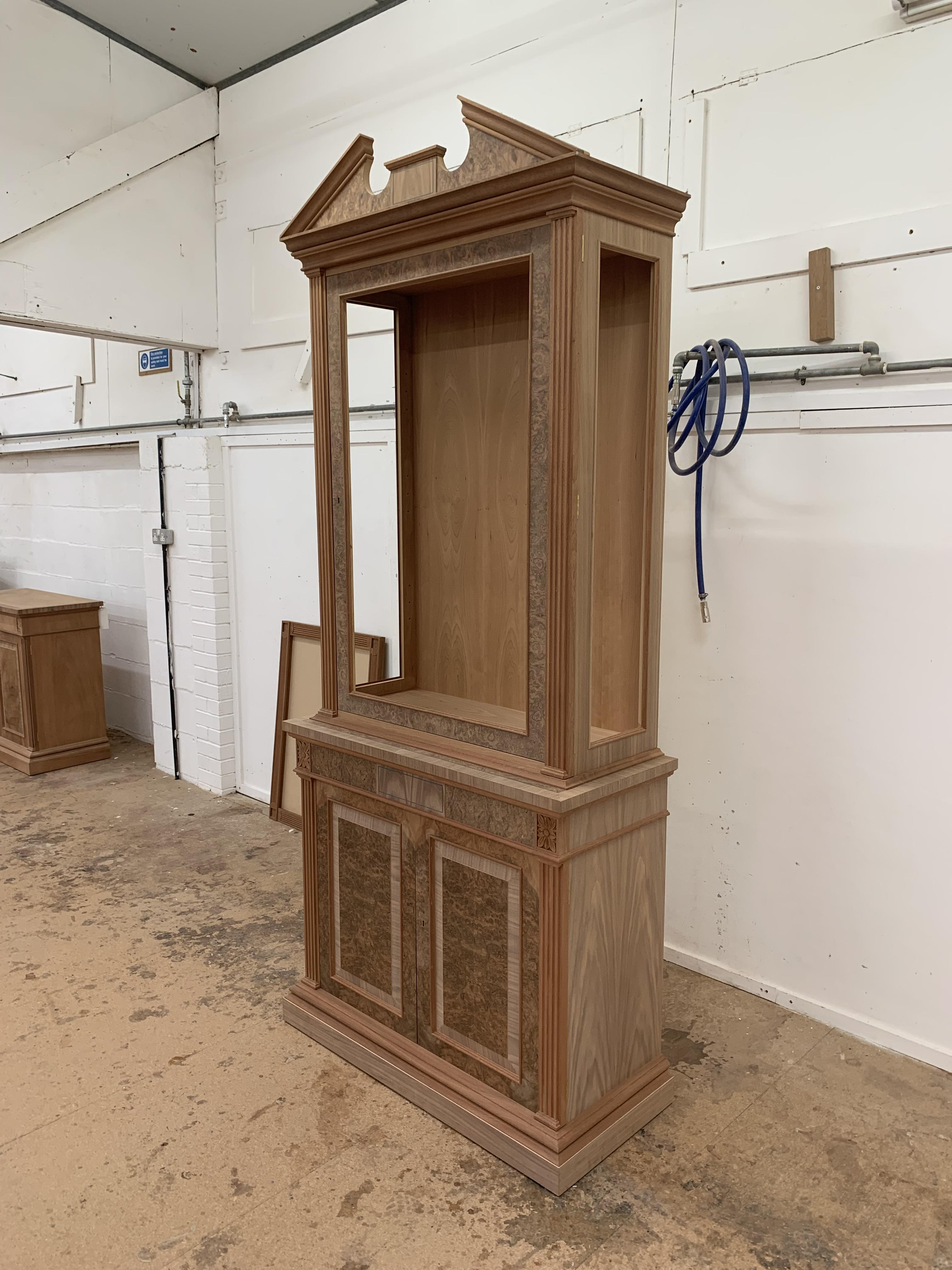Lot 31 - Two-door tall Bookcase, in walnut finish, from the Corinthian range, requires finishing/polishing.