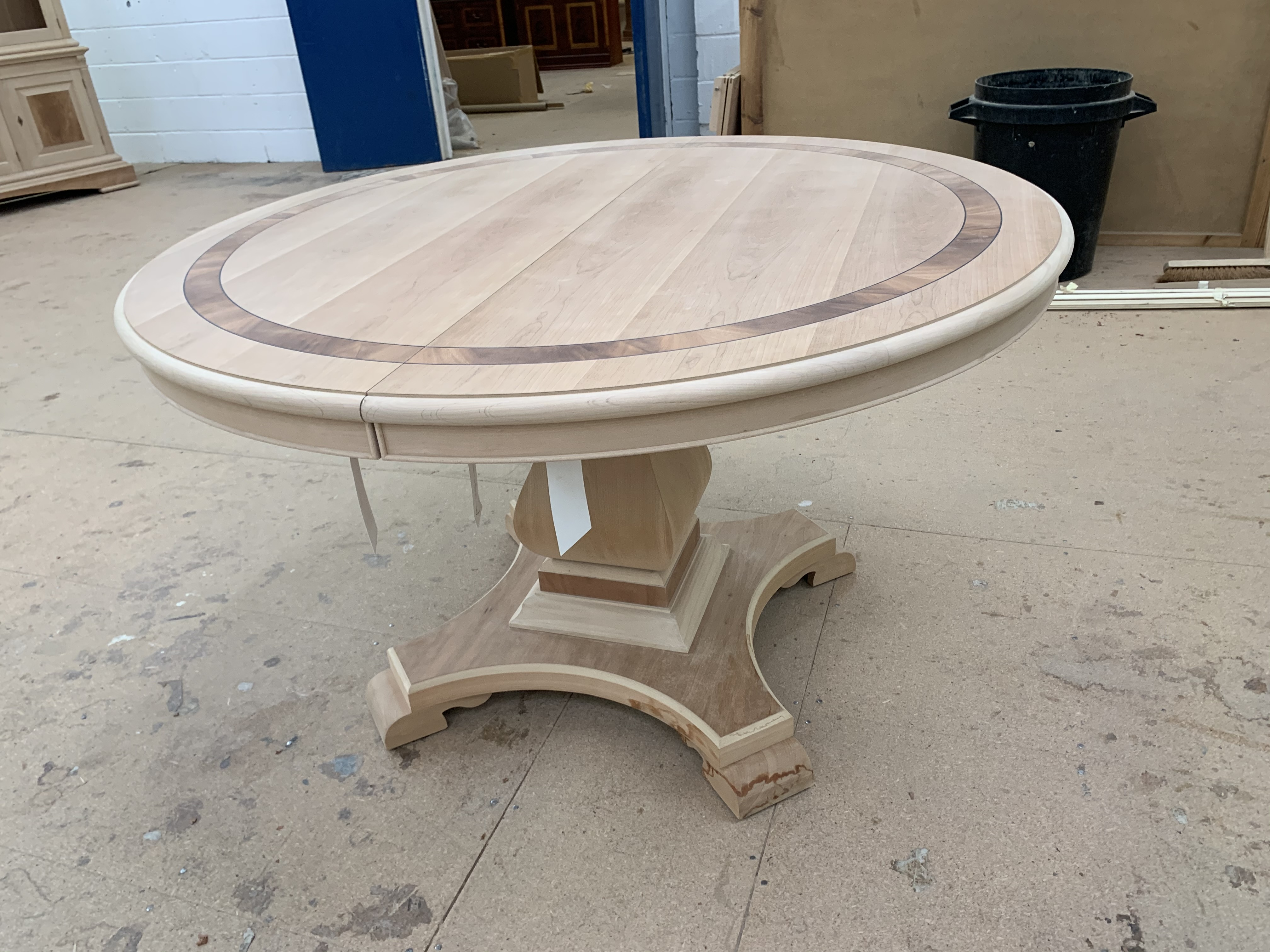 Lot 42 - Single pedestal extending Dining Table, requires finishing/polishing, finished RRP £4152. Model no