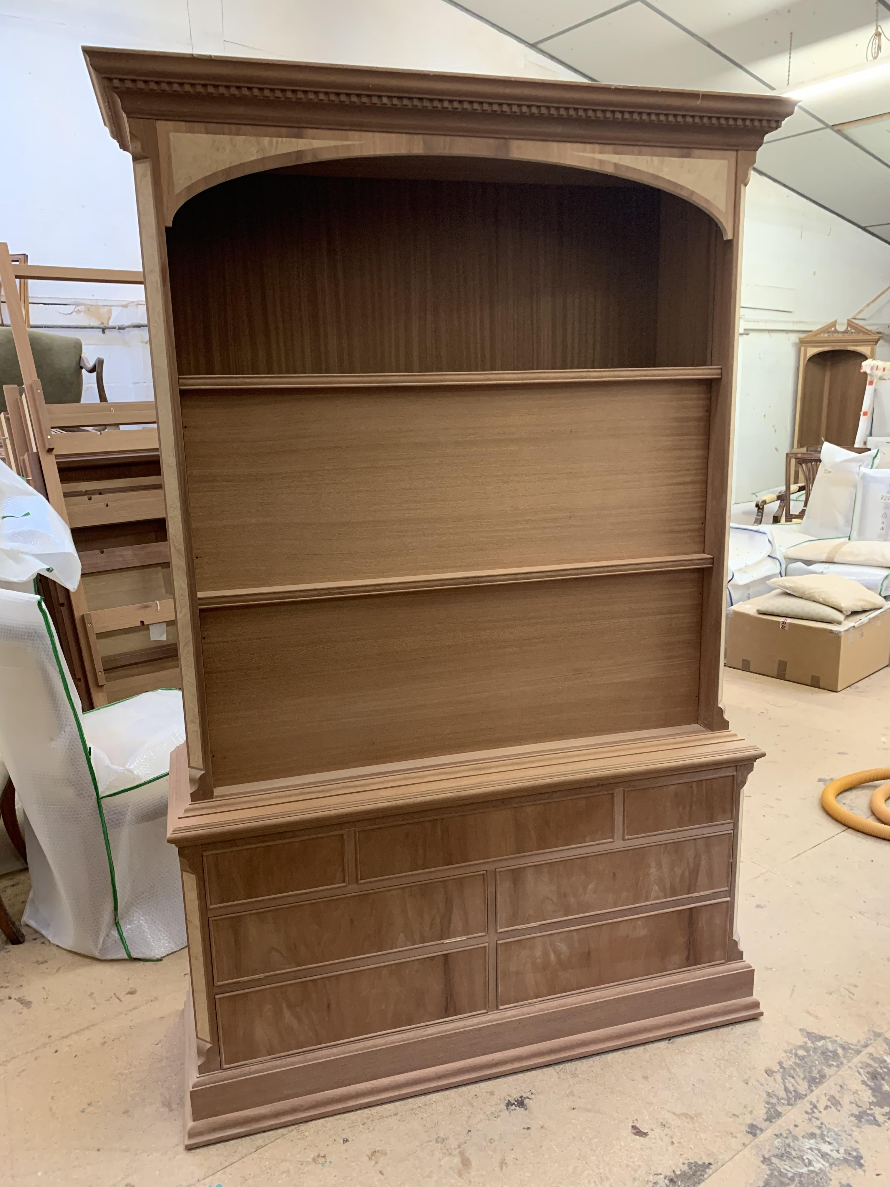 Lot 16 - Flatscreen Television Cabinet, disguised as bookcase, in mahogany finish, requires finishing/