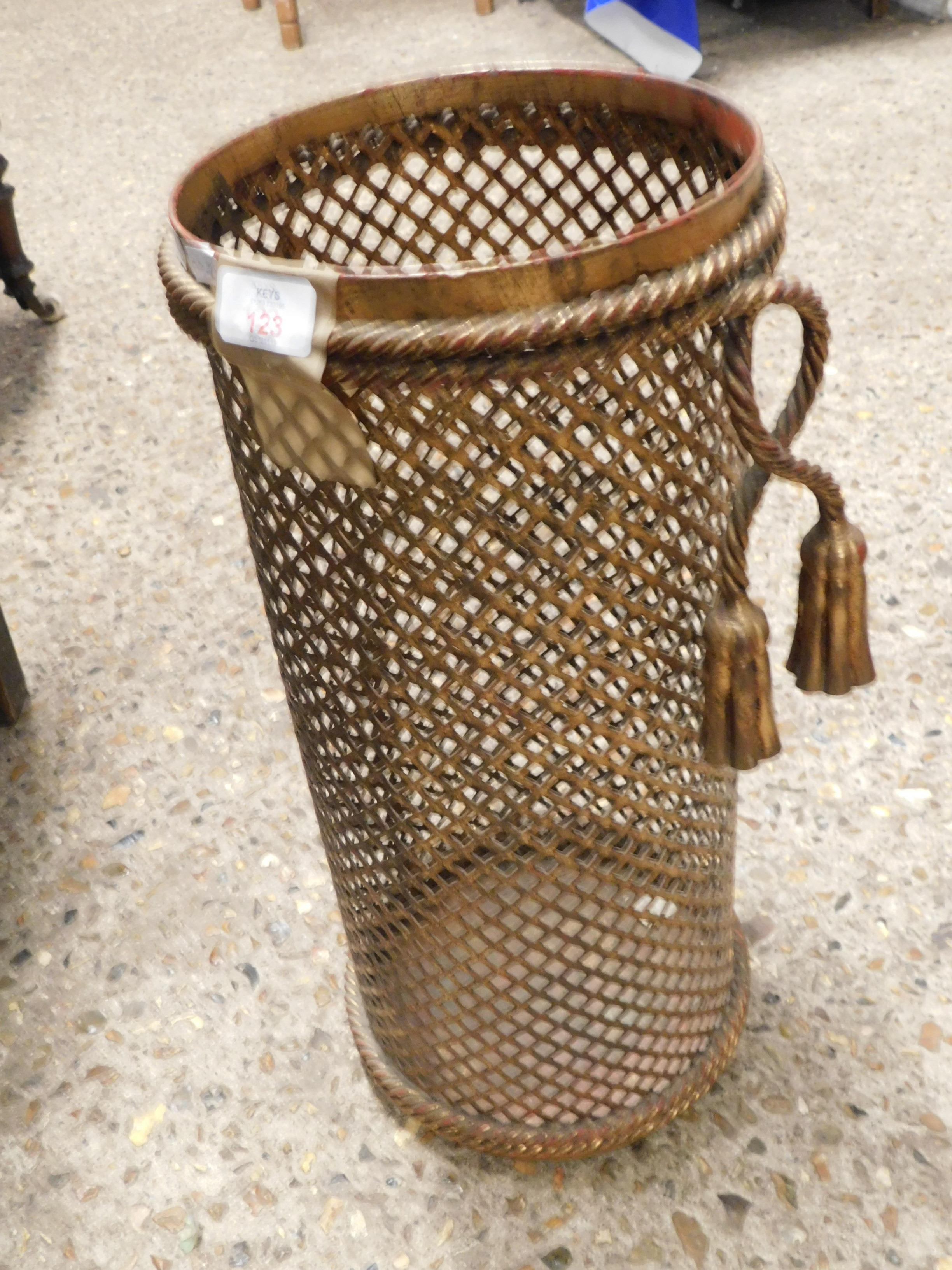 Lot 123 - MODERN GILT METAL CIRCULAR STICK STAND WITH GRILLE DETAIL AND TASSELS