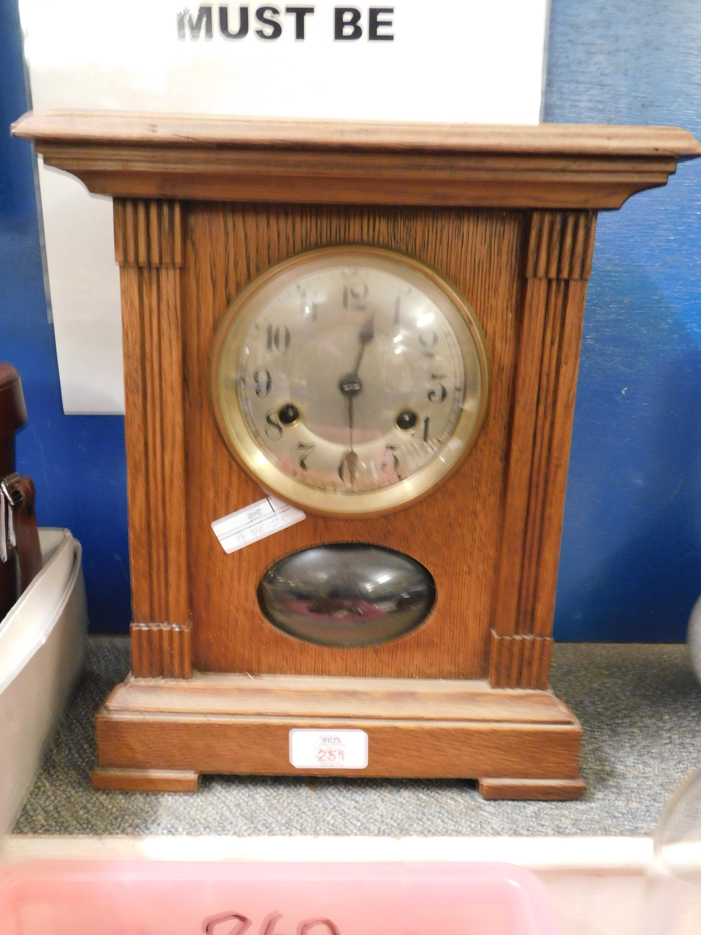 Lot 251 - OAK FRAMED MANTEL CLOCK WITH SILVERED DIAL