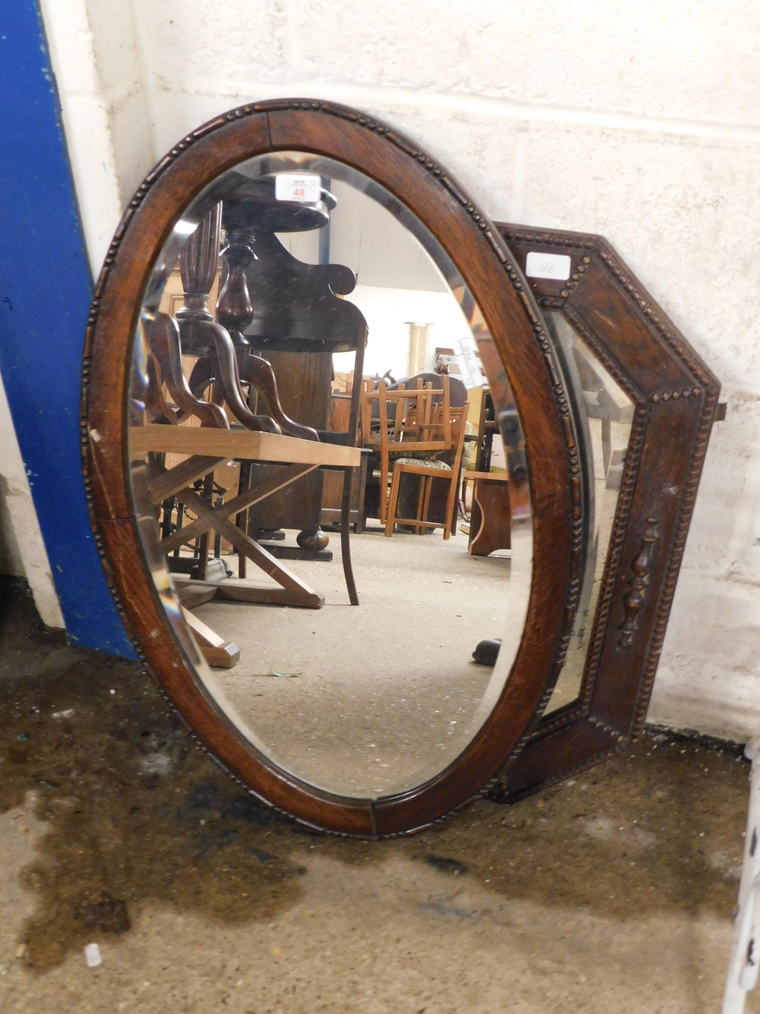 Lot 48 - OAK HEXAGONAL FRAMED WALL MIRROR AND A FURTHER OVAL WALL MIRROR (2)