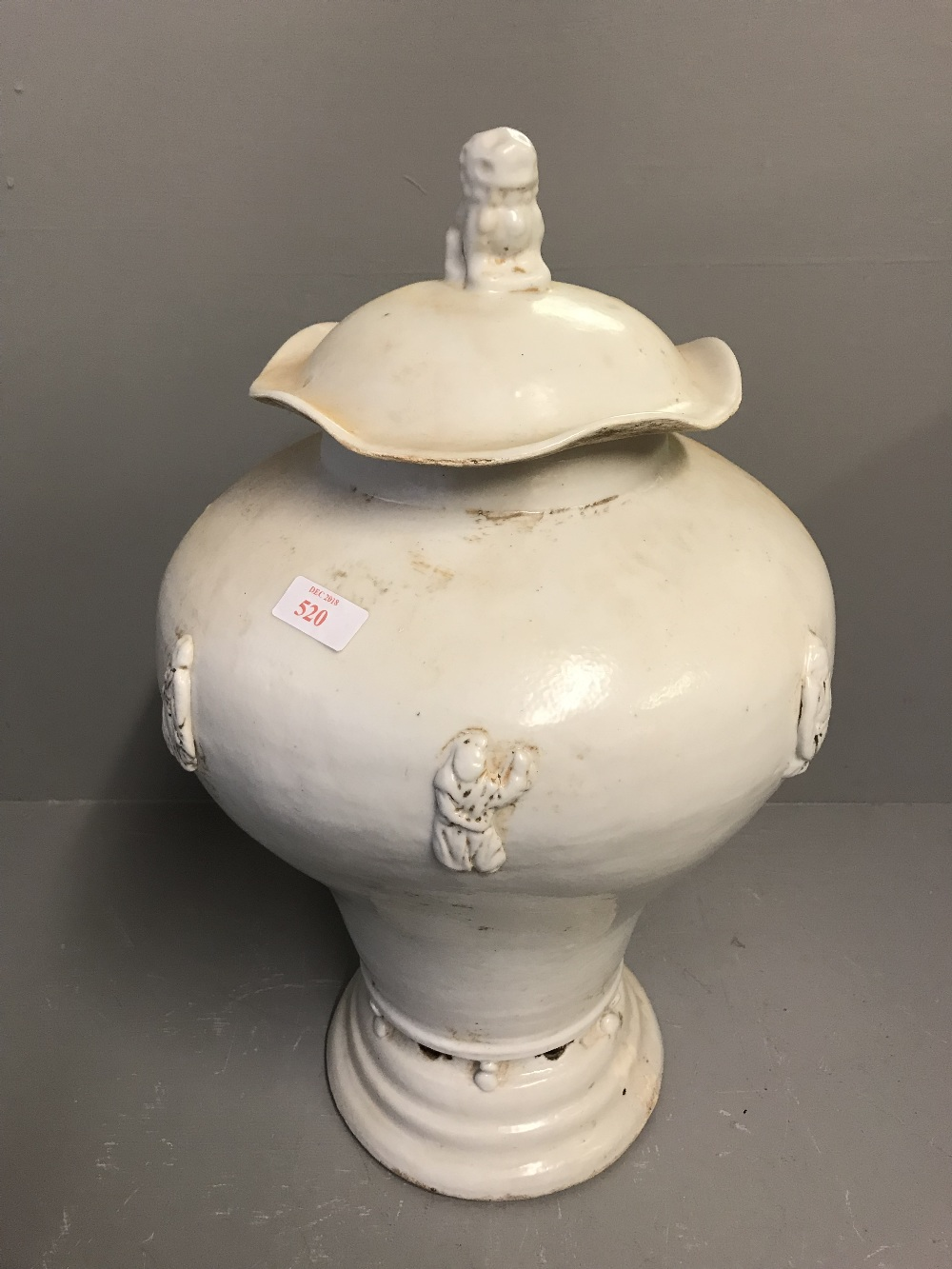 Lot 103 - White lidded Chinese urn 50cm H, decorated with figures, the lid topped with a dog of Fo