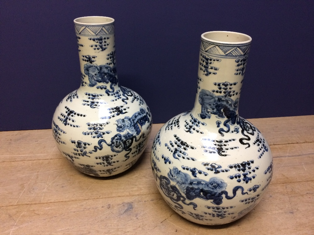 Lot 99 - Pair Chinese onion shaped blue & white vases 60cm H