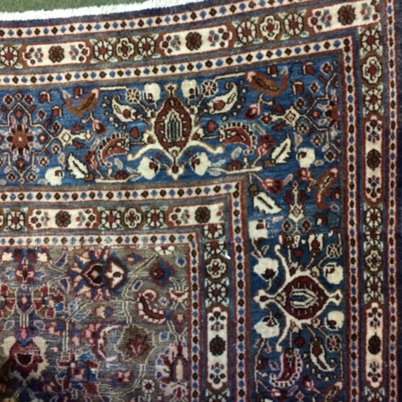 Lot 699 - Large blue rug