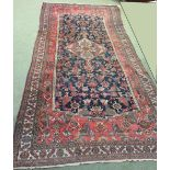 Lot 727 - Persian rug geometrically decorated in shades of red, blue & beige 470 X 204cm