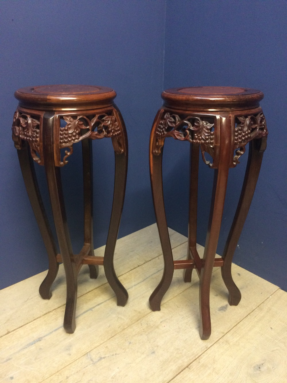 Lot 100 - Pair of ornate wooden display stands for vases 82cm H