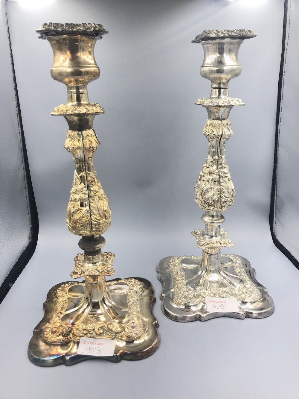 Lot 903 - Pair of heavy white metal candlesticks