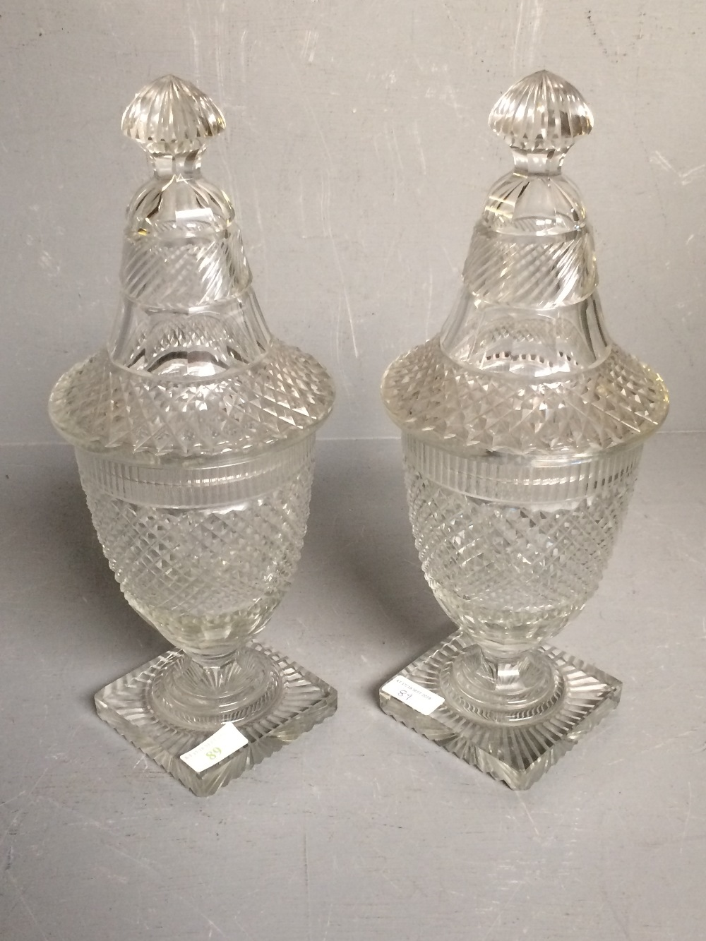 Lot 89 - Pair of hobnail cut glass sweet meat jars with lids 37.5 cm